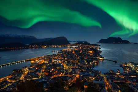 Northern lights - Green Aurora borealis over Alesund, Norway